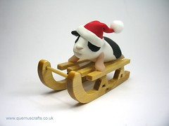Little Sledging Guinea Pig (QuernusCrafts) Tags: christmas cute guineapig decoration polymerclay santahat sledging quernuscrafts sledgingguineapig