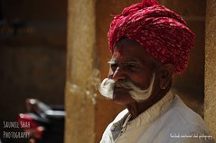 The Grand Guard (Saumil U. Shah) Tags: street portrait india man color colour colors temple colours indian guard streetphotography grand personality moustache turban jaisalmer rajasthan shah saumil spectrallines saumilshah therealsaumil