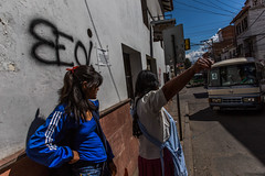 Hail taxi ! (Frédéric Loward) Tags: street city woman bus waiting taxi streetphotography bolivia sucre hailing