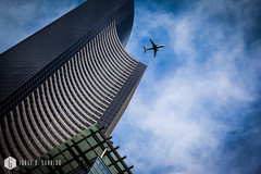 airplane with modern building in Seattle business district, Washington State (doctor.calavera) Tags: guangzhou china seattle city travel blue sky urban usa abstract building tower glass skyline architecture modern america skyscraper plane airplane corporate flying washington office asia cityscape exterior view district background aircraft aviation air north central flight scene aeroplane business commercial transportation below rise financial metropolitan freight airliner upward finance