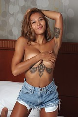 Topless in Denim (lilbitrisque) Tags: cute sexy beautiful shirt tattoo pose athletic bed model bedroom breasts tits legs boobs modeling gorgeous tan posing stomach tattoos thighs barefoot denim shorts lovely toned mixedrace sexiness 20something nobra implied handbra braless impliednude