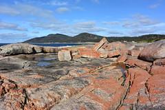 Bicheno, Tasmania (Marian Pollock - Thanks for a million+ views) Tags: red beach clouds rocks patterns australia tasmania waterscape rockpools vulcanic bicheno