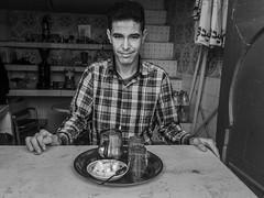 Tea Vendor (Mayur Shivz - Out and about casual photography) Tags: tea vendor mint morocco essaouira portrait black white bw panasonic lumix fz18 candid casual simple pot glass sugar cubes beach marrakech