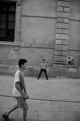 (pieroemme) Tags: child playing people potraiture streetphotograpy street streetlife bw black blackwhite football cesare ortigia sicily syracuse