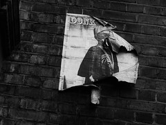 party's over everybody go home (jacobedwardwarner) Tags: urban monochrome blackandwhite london city capital england mixed media bricks wall decay weathered poster graffiti art artistic advert sony hx300 digital photography