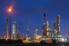 Oil refinery or petroleum refinery industry in industrial estate, industrial process plant where crude oil is processed and refined into more useful products. Oil refineries use much of the technology (Bee-Teerapol) Tags: auto automobile boil boiler capacity chemical chemistry chimney energy engineer engineering environment factory fuel gas gasoline heavy industrial industry landscape light liquid manufacturing metal night oil petrochemical petroleum pipe pipeline plant pollutant pollute pollution power product production refine refinement refinery sky smoke sphere steam storage tank technology tower twilight worker