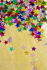 Colorful stars on gold background, portrait (PicciaNeri) Tags: glow festivities glitter starshape xmas christmas starnight seasonal festive celebration text birthday aspirations goldstar background black decorative card celebrate sparkle confettistars motif december present goldenconfetti goldconfetti winter gift border color party goldstars gold confetti star dreams goldenstars greetings holidaycard blue colorful holiday blank message ornate metallic decoration closeup goldenstar nobody copyspace happy golden