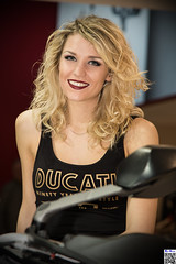 EICMA 2016 - II (tnekralc) Tags: eicma 2016 blonde hair face smile teeth eyes beautiful woman shoulders arms