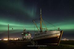 The other side of Hlmsteinn (Kjartan Gumundur) Tags: iceland sland garur boat stars sky auroraborealis northernlights norurljs nightscape nightphotography nocturne nordlys ngc canoneos5dmarkiv tokinaatx1628mmf28profx kjartangumundur arctic photoguide polarlict