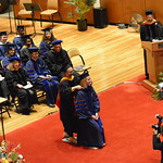 Kristin Divis is hooded by Frances Wang, Associate Head for Graduate Affairs