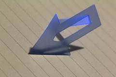 Arrow (me.behindthelens) Tags: macromonday arrow shadow bookmark plastic clip