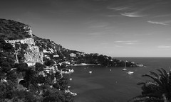 summer heat at the French Riviera (lunaryuna) Tags: sea summer sky bw mountain seascape france monochrome season boats bay coast blackwhite cotedazur mood tunnel heat coastline lunaryuna constructions frenchriviera baiedestlaurent