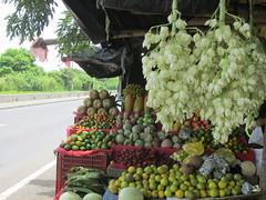 State flower at fruit stand (Nancy D. Brown) Tags: flowers fruit elsalvador
