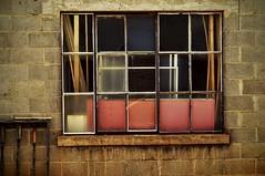 Wood behind glass (hutchphotography2020) Tags: windows rust panes cementblocks