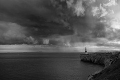 A Tinge of Sadness (sebistaen) Tags: winter sea sky cloud lighthouse white black rain flickr gibraltar sbastien europapoint lemercier sebistaen