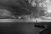 A Tinge of Sadness (sebistaen) Tags: winter sea sky cloud lighthouse white black rain flickr gibraltar sébastien europapoint lemercier sebistaen