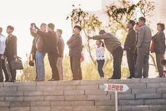 Locals and Foreigners enjoying the Parade (reubenteo) Tags: city red tourism war asia fireworks military korea parade communism celebration kimjongil vip metropolis comrade socialism tanks workersparty northkorea pyongyang 70thanniversary dprk kimilsung kimjongun