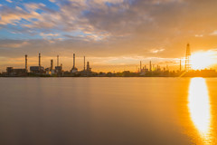 Oil refinery or petroleum refinery industrial process plant with sunrise, oil refineries use much of the technology, as types of chemical plants, the downstream side of the petroleum industry. (Bee-Teerapol) Tags: refinery oil industrial industry petroleum landscape plant petrochemical construction factory sunset energy gas technology metal environment power tower chemical production petrol sky dusk business light silhouette engineering tube fuel chemistry chimney pipeline global pollution sunrise movement future gasoline heavy boil boiler capacity process processing manufacturing useful products transport safety environmental