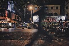 Running by. (Khuroshvili Ilya) Tags: india mumbai shadow moving cafe leopold night streets taxi people running man lights city facade advertisement trash colaba ngc portfolio streetphoto fineart moment