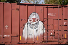 ? (TheGraffitiHunters) Tags: graffiti graff spray paint street art colorful freight train tracks benching benched boxcar face floater