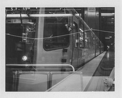 DoubleMuni (Jeremy Brooks) Tags: bw blackwhite blackandwhite california doubleexposure film muni roidweek2016 sanfrancisco sanfranciscocounty station train transit usa camera:make=polaroid camera:model=landcamera100