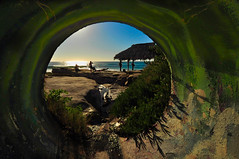 Third Eye (kirstenscamera) Tags: socaldrainwaterfront california sandiego lajolla windansea tikihut tiki afternoon sunset light tunnel pipe beach coast shore pacificocean green sandstone sand water sd ca serene yoga