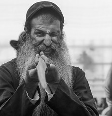 The Jewish Samurai examines his new sword (ybiberman) Tags: israel jerusalem meahshearim man jew portrait beard hat winking sukkot suckot lulav closedfrondfromadatepalm bw