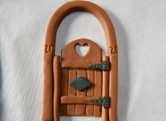 Garden gate for this years Gingerbread house! (ineedathis,The older I get the more fun I have....) Tags: gardengate heart macro gingerbreadhouse christmas2016 baking gate modeling sugarwork miniatures gumpaste edible woodendoor ironwork door hinches nikond750 nails macromondays