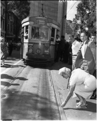 Woman puts coin on the rails on last (?) day of trams, Sydney, 26 February 1961 / unknown photographer (State Library of New South Wales collection) Tags: statelibraryofnewsouthwales