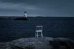 The Outpost (Fredrik Lindedal) Tags: ocean coast cold lighthouse chair rocks rock sweden visitsweden sverige nikon outpost fredriklindedal water