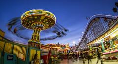 Sea Swings (matman73072) Tags: santacruz boardwalk amusementpark rides rollercoaster giantdipper swings flatride spinner bluehour motionblur fisheye