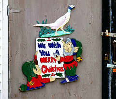 We Wish You a Merry Christmas (Colorado Sands) Tags: merrychristmas canada newfoundland littleport christmas sandraleidholdt door elves sign text canadian rougharoundtheedges