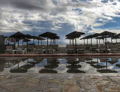 It's not always Sol on the Costa (Peter H 01) Tags: beach rain clouds puddle nerja parasols sunbeds burriana