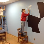 Students painting pictures on the wall of the math lounge