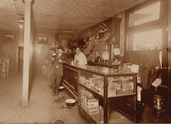 Tavern Interior, Patron Toasting Camera with Beer