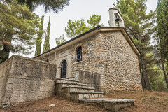 Chapel at dusk (Ivanov Andrey) Tags: church religion history christianity cross chapel bell stairs step wall stone dusk evening pine mountain slope hill forest needles tree bush grass architecture walking travel kalvrita peloponnese greece nikon d810