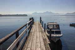 Chiemsee Morning (xmibux) Tags: germany deutschland bavaria bayern chiemsee lake see sunrise morning morgen sonnenaufgang harbour steg boat boot mountains berge alps alpen