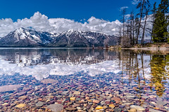 rocks and reflections -Explore (Marvin Bredel) Tags: explore marvinbredel grandtetonnationalpark rocks mountains clouds water lake jacksonlake reflections sonyilce7s sonya7s wyoming jacksonhole clearwater