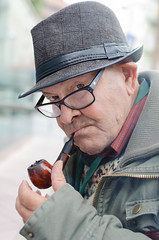 Holmes (Luis Alvarez Marra) Tags: salou spain catalonia nikon d7000 35mm prime candid portrait color street tog streettog pipe hat outdoor collecting soul decisive moment