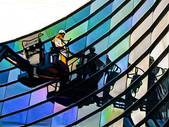 True Colours (Steve Taylor (Photography)) Tags: window washing washer art digital building architecture black blue green brown mauve pastel purple rainbow white up glass man workman newzealand nz southisland canterbury christchurch city cbd reflection cherrypicker gallery lift whenimcleaningwindows