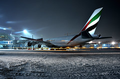 Frozen night (Nick Aviator) Tags: jet airbus airplane aircraft a380 aviation air emirates airline airlines uae moscow russia night snow airport domodedovo uudd longexposure long exposure terminal building gate apron lights sky dark blue