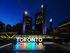 Toronto City Hall At Twilight .... Toronto, Ontario (Greg's Southern Ontario (catching Up Slowly)) Tags: color colour reflections lights twilight dusk cityhall bluehour reflectingpool torontocityhall torontoist reflectivewaters