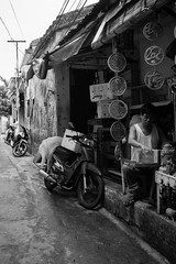 In to the distance (stevenp74) Tags: street white man black monochrome asia sony streetphotography bikes vietnam scooters a7