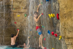 Climbing Wall Waterfall [Explore] (aaronrhawkins) Tags: thanksgiving park boy wet water pool girl wall swimming fun utah waterfall colorful cousins aaron indoor drop suit climbing splash wendell provo hawkins ritchie submerge drench provorecreationcenter