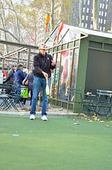 Juggler II (thoth1618) Tags: park christmas nyc newyorkcity red orange ny newyork yellow december manhattan pins plastic bowling juggling juggler bowlingpins bryantpark 2015