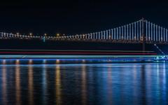 transbay express (pbo31) Tags: sanfrancisco california bridge urban motion black color reflection ferry night dark bay nikon december baybridge embarcadero sail 80 2015 lightstream boury pbo31 d810