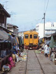 Thailand - Samut Songkhram - A train through the market (railasia) Tags: thailand market infra nineties srt samutsongkhram narrowpassage metergauge manrail motorcarcontrollercoach maeklonglines