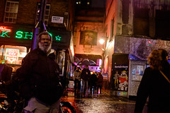 Leaning on a Lamp Post (Michael Goldrei (microsketch)) Tags: street light people man london film wet against lamp face rain weather sign st sex shop night court dark t photography book photo crt long exposure neon fuji photographer darkness post faces bright time photos jan soho homeless january x nighttime lamppost walker rainy lampost alleyway fujifilm after 100 16 raining walkers leaning brewer vagrant drizzle lean 2016 xseries drizzling drissle x100t drissling