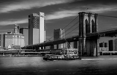 Brooklyn Bridge (nicolaspika) Tags: nyc spring bridge ny eastriver clouds brooklyn brooklynbridge lowermanhattan travel bw newyork architecture boat holidays blackandwhite usa trip unitedstates us olympus