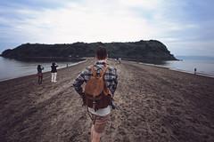 (Chiringashima) (Mark Liddell) Tags:  chiringashima japan travel kyushu ibusuki kagoshima     water sea island sandbar low tide beach markliddell me self portrait scottish boy man guy leather backpack traveller tourists people view blue sky clouds back shorts flannel shirt footprints sand